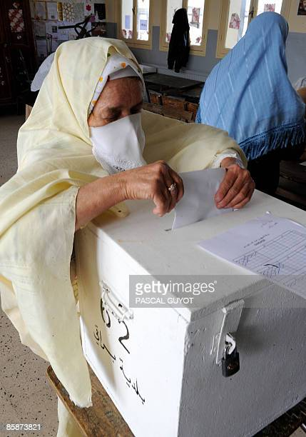 A woman casts her ballot in a school in Algiers on April 9 2009 during the presidential election Algerian President Abdelaziz Bouteflika is hoping...