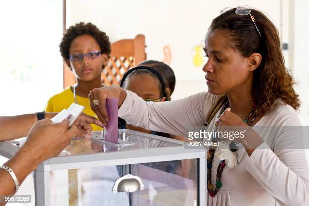 A woman casts her ballot in the polling station of Cayenne on the French South American territory of Guiana on January 10 for the referendum on the...