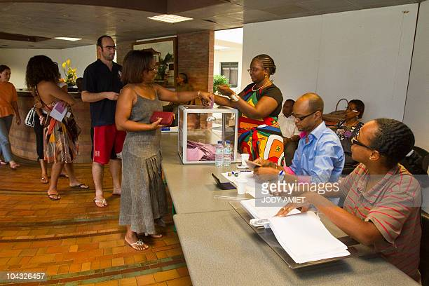 A woman casts her ballot in the polling station of Remire Montjoly on the French South American territory of Guiana on January 10 for the referendum...