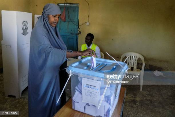 A woman casts her ballot in the Presidential election at a polling station in Hargeisa Somaliland on November 13 2017 Three candidates are running...