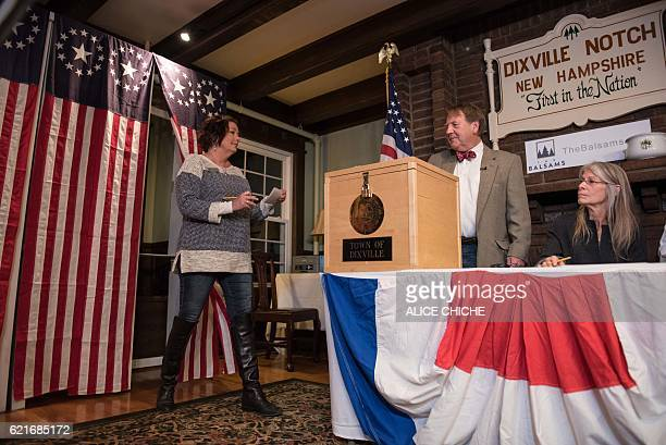A woman casts her ballot inside a polling station just after midnight on November 8 2016 in Dixville Notch New Hampshire the first voting to take...