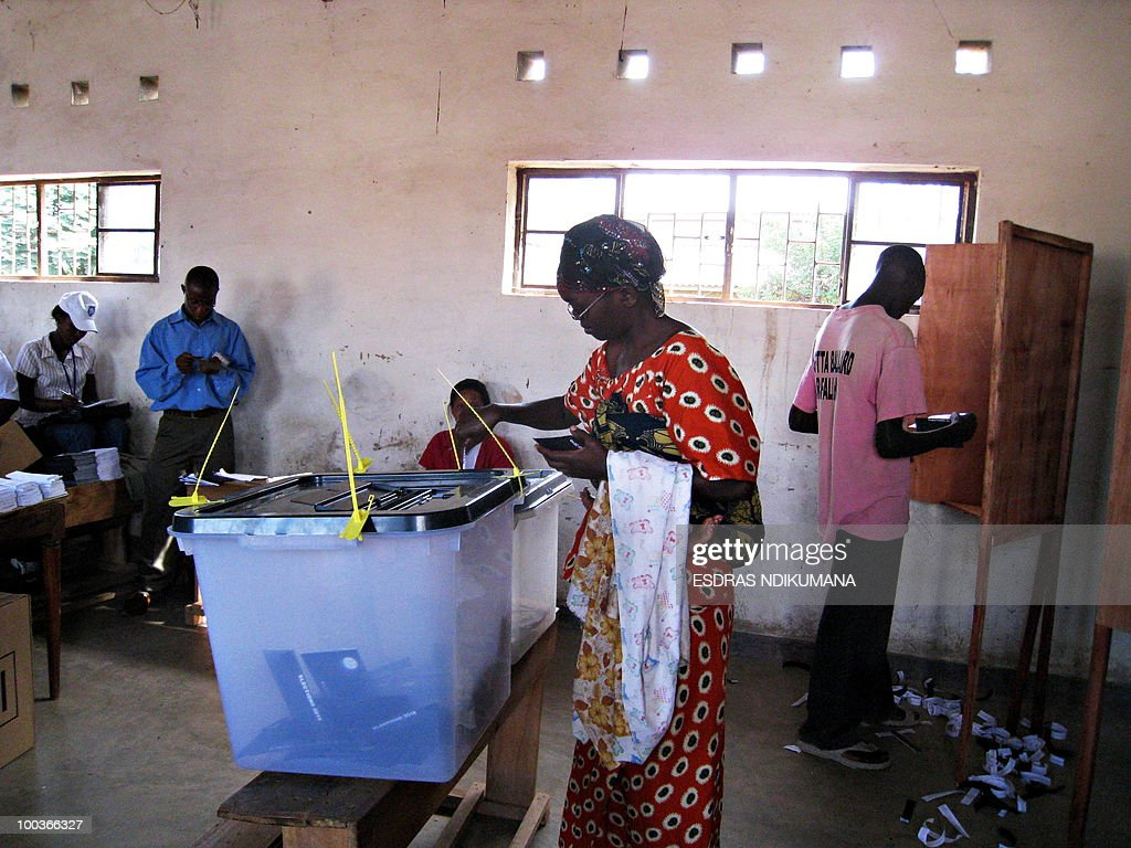 A woman casts her ballot on May 24, 2010 at a polling station in the capital Bujumbura. Local polls kicked off on May 24 in Burundi, the first phase of an electoral marathon set to put the small, war-scarred African nation's peace deal and democratic credentials to the test. Polling stations opened at 6:00 am (0400 GMT), with some 3.5 million voters called to pick local councillors in a ballot seen a key test for presidential and legislative elections due in June and July respectively.