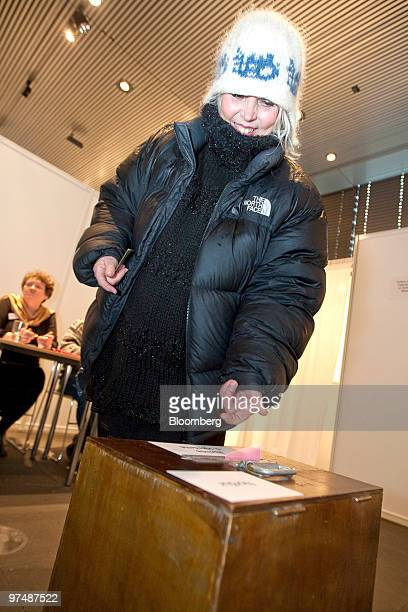 A woman casts her ballot paper in the Icelandic national referendum at a polling station in Reykjavik Iceland on Saturday March 6 2010 Icelanders are...