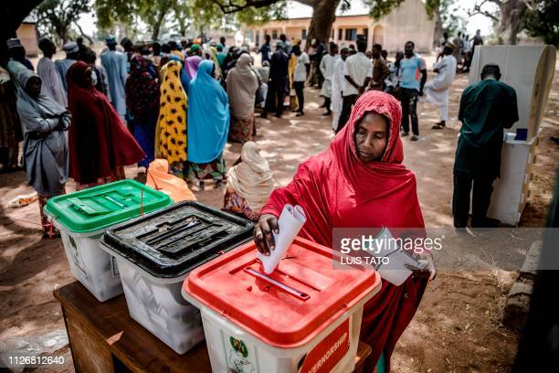 TOPSHOT A woman casts her ballot to vote in the presidential and parliamentary elections at a polling station at the Malkohi refugee camp in Jimeta...