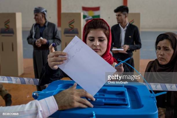 A woman casts her referendum vote at a voting station on September 25 2017 in Erbil Iraq Despite strong objection from neighboring countries and the...
