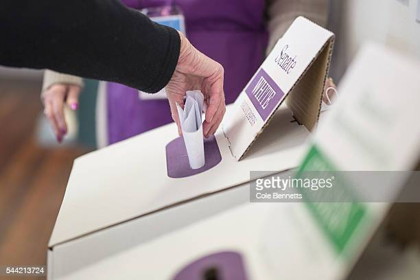 A woman casts her Senate vote at Kingswood Park Public School hall in the electorate of Lindsay on July 2 2016 in Penrith Australia Voters head to...