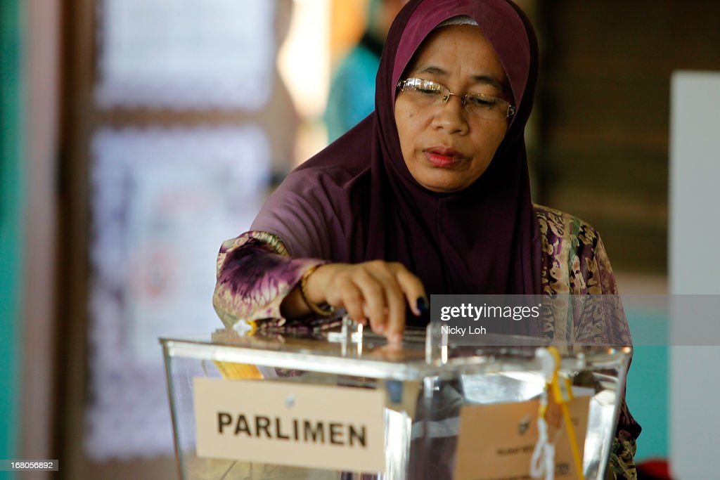 A woman casts her vote a polling station during election day on May 5, 2013 in Pekan, Malaysia. Millions of Malaysians casted their vote on Sunday in one of the most tightly contested Malaysian election since independence in 1957. The opposition coalition, Pakatan Rakyat (PeopleÕs Alliance), led by former deputy prime minister Anwar Ibrahim is seeking to gain power on a national level against the ruling party Barisan Nasional.