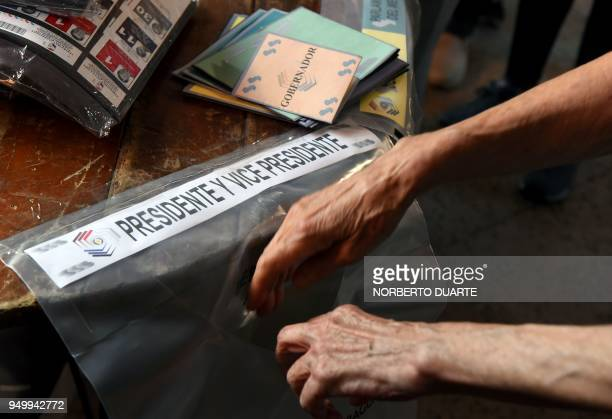 A woman casts her vote at a polling station during general elections in Asuncion on April 22 2018 Opinion polls give Mario Abdo Benitez of the ruling...
