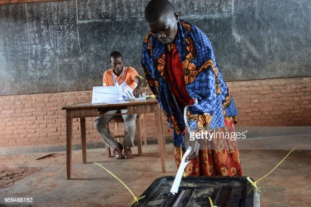 TOPSHOT A woman casts her vote at a polling station in Ciri northern Burundi on May 17 2018 during a referendum on constitutional reforms that if...