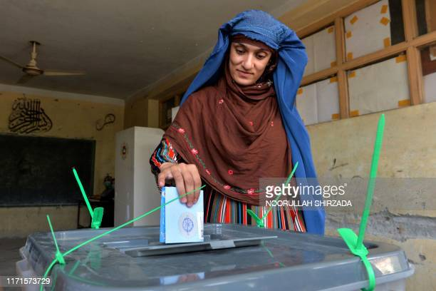 Woman casts her vote at a polling station in Jalalabad on September 28, 2019. - Insurgents worked to disrupt Afghanistan's presidential election on...