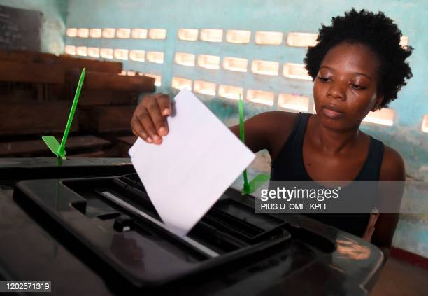 A woman casts her vote at a polling station in Lome on February 22 during the presidential elections Togo went to the polls on February 22 in an...