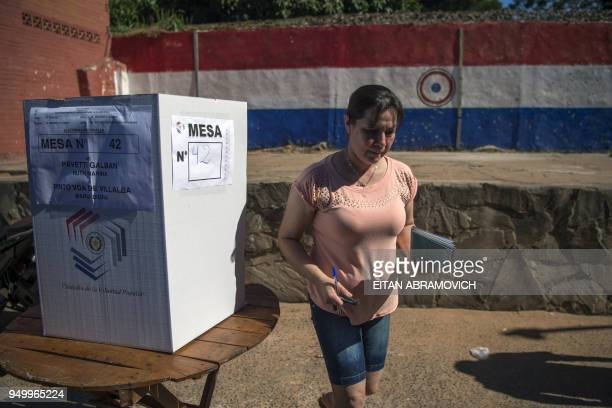 A woman casts her vote at a polling station in Mariano Roque Alonso outskirts of Asuncion on April 22 during Paraguay's presidential election Opinion...