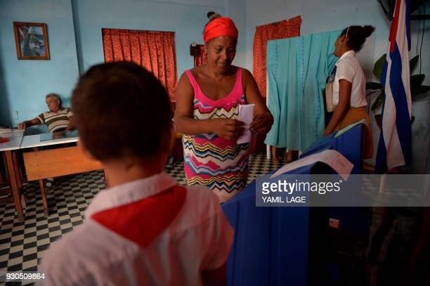 A woman casts her vote at a polling station in Santa Clara Cuba during an election to ratify a new National Assembly on March 11 2018 Cubans vote to...