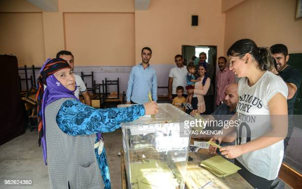 A woman casts her vote at a polling station in snap twin Turkish presidential and parliamentary elections in the Kurdish stronghold of Diyarbakir in...