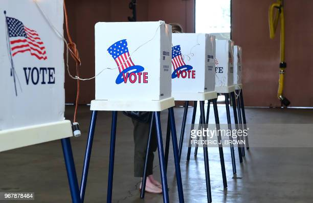 A woman casts her vote at a polling station inside the Alhambra Fire Department in Alhambra Los Angeles County California on June 5 2018 as...