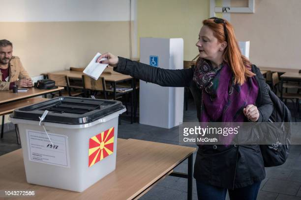 A woman casts her vote at a polling station on September 30 2018 in Tetovo Macedonia Macedonians all across the country went to the polls today to...