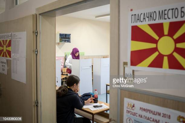 A woman casts her vote at a polling station on September 30 2018 in Skopje Macedonia Macedonians all across the country went to the polls today to...