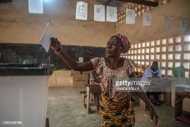 A woman casts her vote at a polling station set up at a public primary school in Lome on February 22 during the presidential elections Togo went to...
