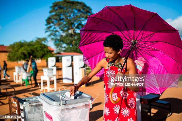 Woman casts her vote at CCAP Primary School polling station during the Malawi Tripartite general elections in Mzuzu, on May 21, 2019. - Malawi went...