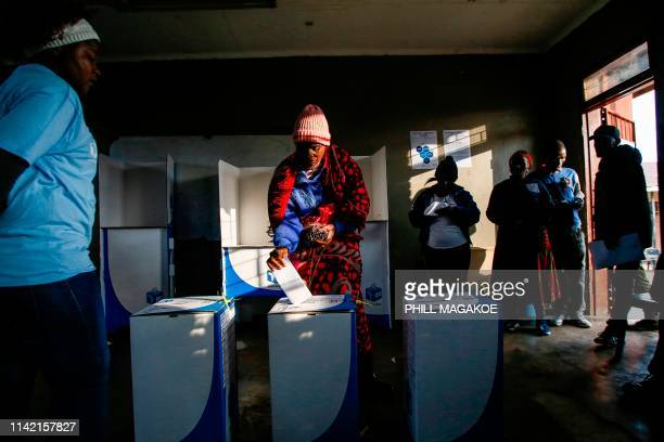 TOPSHOT A woman casts her vote at Rakgatla Secondary School polling station during South Africa's national and provincial elections on May 8 2019 in...