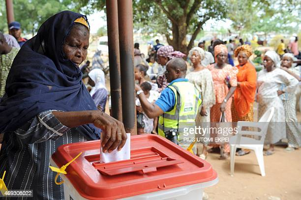 A woman casts her vote at the Epe district of Lagos on April 11 2015 Nigerians were on Saturday voting to choose new state governors and local...