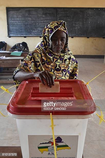 A woman casts her vote at the polling station in the muslim district of PK 5 in Bangui for Central African Republic second round presidential and...