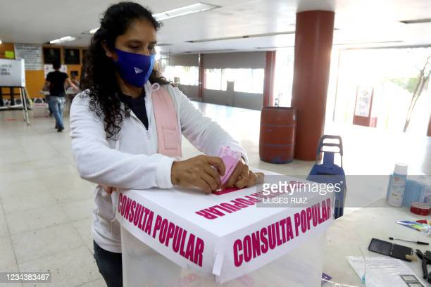 Woman casts her vote during a national referendum in Guadalajara, Jalisco state, Mexico, on August 1, 2021. - Mexicans voted Sunday in a national...