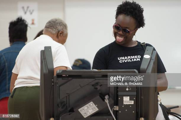 TOPSHOT A woman casts her vote during Missouri primary voting at Jury Elementary School on March 15 2016 in Florissant Missouri