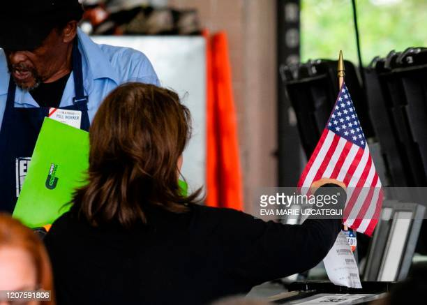 A woman casts her vote during the Florida primary election in Miami Florida on March 17 2020 Millions of anxious Americans troop to polling stations...