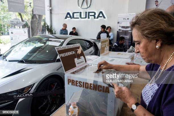 A woman casts her vote during the presidential election at a polling station on a luxury car dealer in Polanco Mexico City on July 1 2018 Sick of...