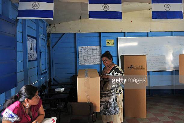 A woman casts her vote in a public school in Managua during municipal elections on November 4 2012 Nicaragans vote to elect 153 municipal mayors 153...