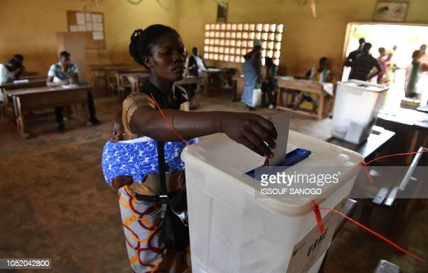 A woman casts her vote in Ivory Coast's regional and municipal elections at a polling station in the town of Katiola on October 13 2018