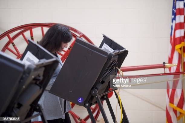 A woman casts her vote in the 2018 Pennsylvania Primary Election at the Hazleton Southside Fire Station polling station on May 15 2018 in Hazleton...