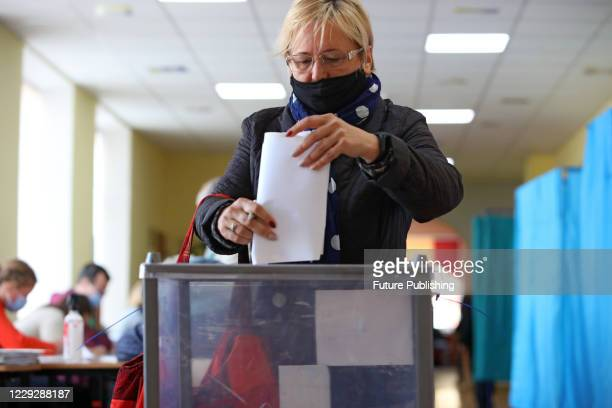 Woman casts her vote in the 2020 Ukrainian local elections at a polling station, Kharkiv, northeastern Ukraine. - PHOTOGRAPH BY Ukrinform / Barcroft...