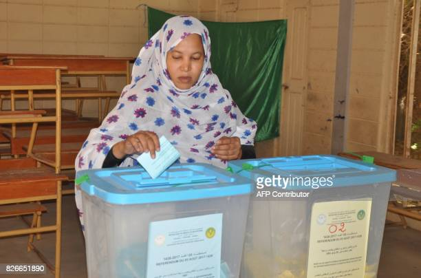 A woman casts her vote in the country 's constitutional referendum on August 5 2017 at the polling station in Nouakchott Mauritanians began voting on...