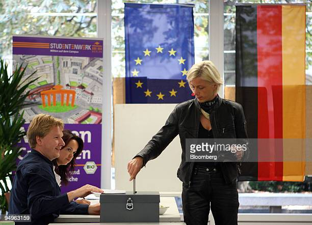 A woman casts her vote in the German federal elections in Berlin Germany on Sunday Sept 27 2009 Germany votes today to decide who steers the European...