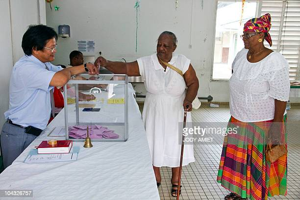 A woman casts her vote in the polling station of Cayenne on the French South American territory of Guiana on January 10 for the referendum on the...