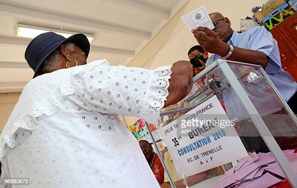 A woman casts her vote in the polling station of the Trenelle Citron quarter of FortdeFrance on the Caribbean island of Martinique on January 10 for...