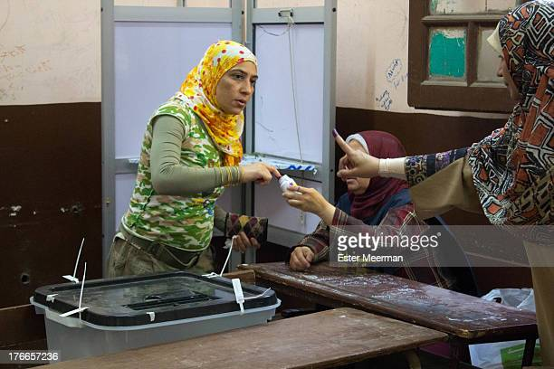 CONTENT] A woman casts her vote in the second round of the presidential elections in Egypt on June 16th 2012