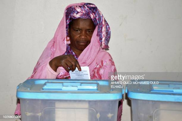 A woman casts her vote on September 1 2018 at a polling station in Nouakchott for the country's legislative regional and local elections Mauritania a...