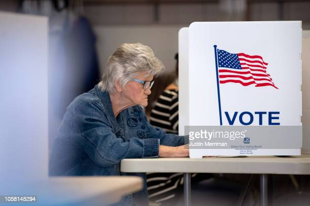 A woman casts her votes at the Guernsey County Senior Center polling location on November 6 2018 in Cambridge Ohio Turnout is expected to be high...