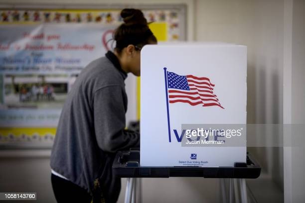 A woman casts her votes the Called to Freedom Fellowship Church polling location on Election Day on November 6 2018 in Cambridge Ohio Turnout is...