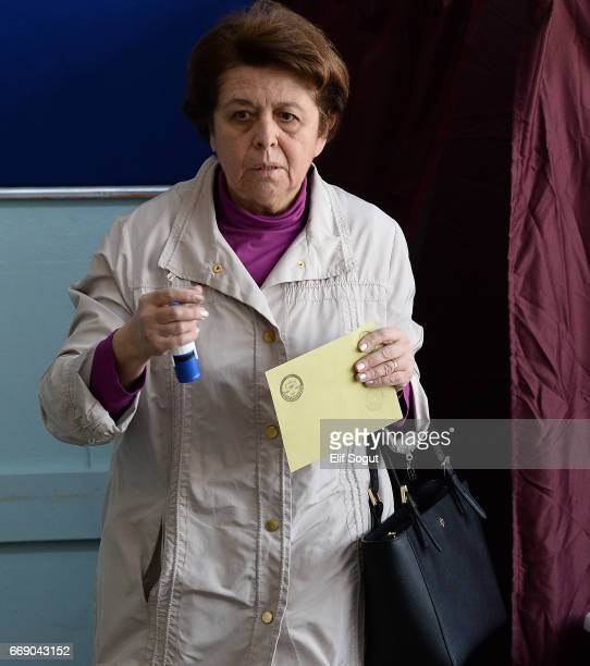 A woman casts his ballot at a polling station during a referendum in Ankara April 16 2017 Turkey Millions of Turks are heading to the polls to vote...