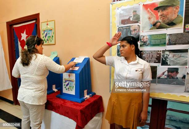A woman casts his vote during National Assembly Elections on March 11 2018 in Havana Cuba