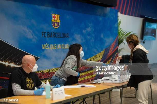 Woman casts in Catalan elections at the Barcelona Camp Nou Stadium, on February 14, 2021 in Barcelona, Spain. In a survey, a third of those chosen by...