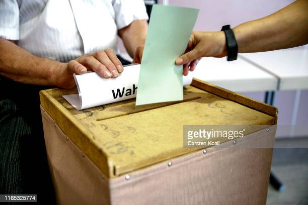 A woman casts the ballot in a polling station in Saxony on September 1 2019 in Crostwitz near Dresden Germany Saxony and the neighboring state...