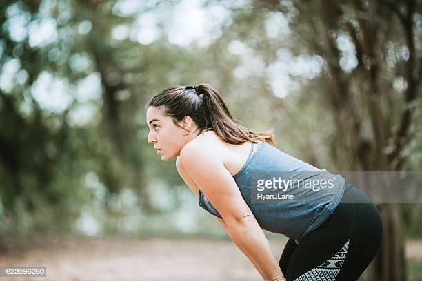 Woman Catching Breath After Exercise