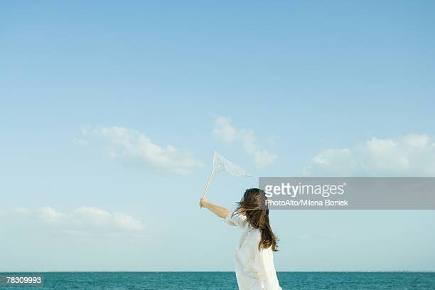Woman catching clouds with butterfly net