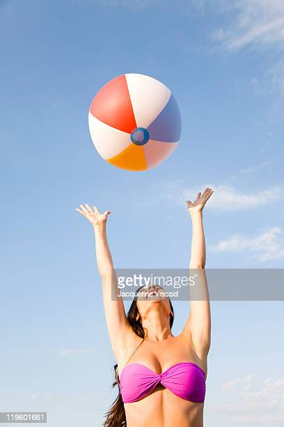 Woman catching colorful beach ball