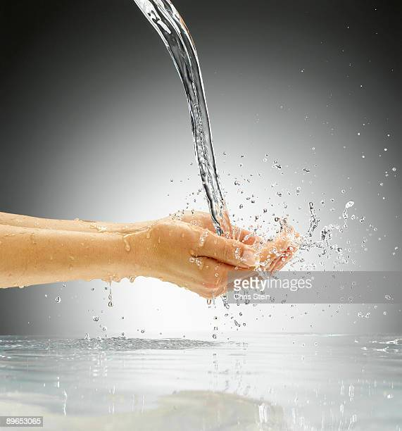 Woman catching pouring water